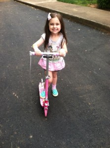 Our 4 1/2 year old grand daughter Eden on her new scooter
