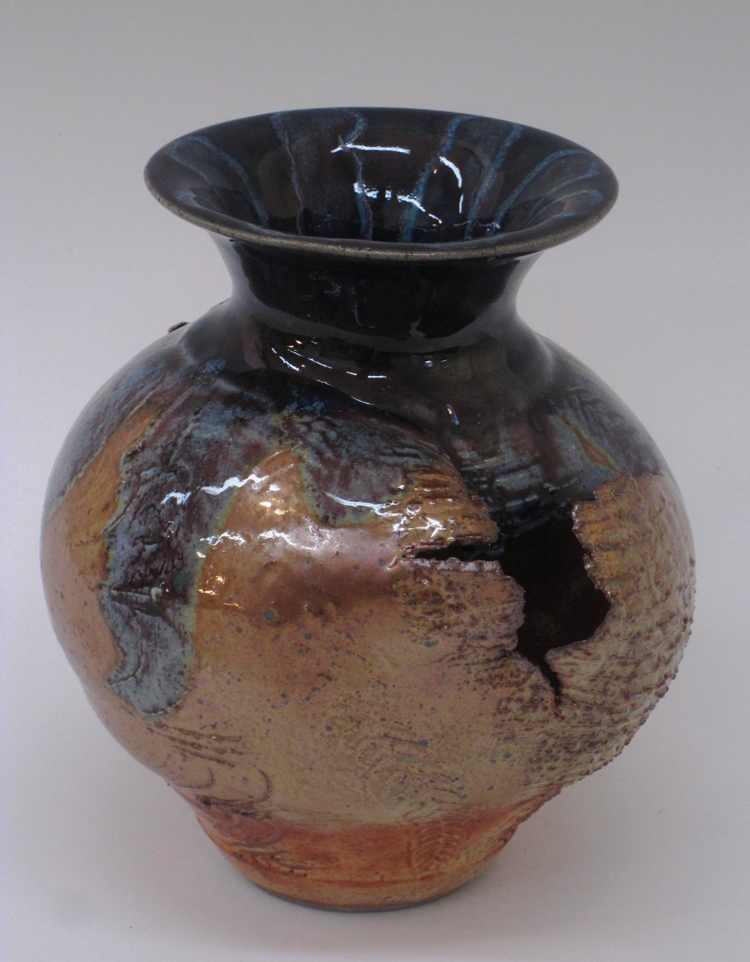 "item # 242   7"" x 7""  Split  and Torn Vase"